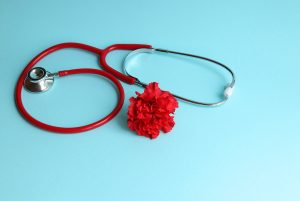 Stethoscope with a red carnation