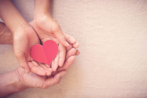 Hands with heart conveying compassion